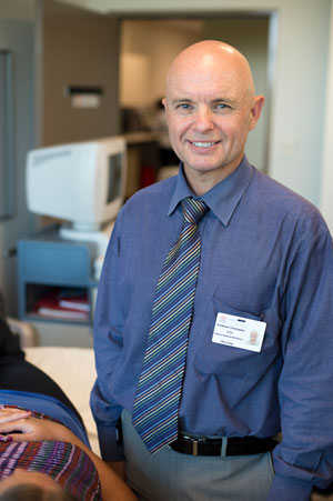 Professor Chris Levi with patient