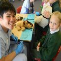 Medicine student Stuart Sugito assessing a teddy at a public school